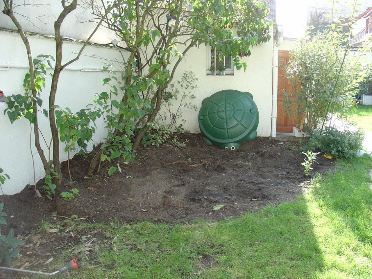 travaux-amenagement-jardin-1-decaissement-graviers-ferraillage -coulage-d'une-dalle-en-beton-texas-batiment-rge-min