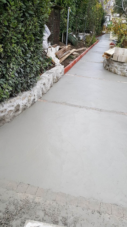 travaux-de-renovation-beton-decoratif-lave-desactive-graviers-galets-demolition-amenagement-exterieur-3.6-maghawry-texas-batiment-rge-min